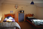 A08BK5 Boys twin bedded cottage bedroom with beds and chest of drawers