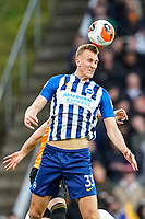 7th March 2020; Molineux Stadium, Wolverhampton, West Midlands, England; English Premier League, Wolverhampton Wanderers versus Brighton and Hove Albion; Dan Burn of Brighton & Hove Albion jumps high to head the ball forward