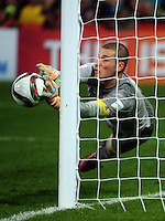 Serbia keeper Predrag Rajkovic makes a save during the FIFA Under-20 Football World Cup Final between Brazil (gold) and Serbia at North Harbour Stadium, Albany, New Zealand on Saturday, 20 June 2015. Photo: Dave Lintott / lintottphoto.co.nz