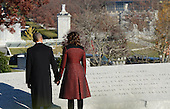 United States President Barack Obama and First Lady Michelle Obama pause at the memorial for President John F. Kennedy at Arlington National Cemetery in Arlington, Virginia, November 20, 2013. This Friday will mark the 50th anniversary of the assassination of President Kennedy on November 22, 1963. <br /> Credit: Pat Benic / Pool via CNP