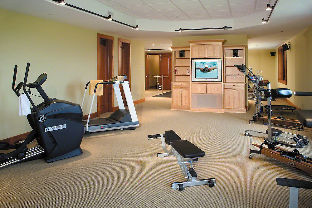 Exercise Room With TV Build In Cabinet