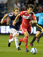 Chicago midfielder Baggio Husidic (9) dribbles away from Chivas midfielder Blair Gavin (18).  The Chicago Fire tied Chivas USA 1-1 at Toyota Park in Bridgeview, IL on May 1, 2010.