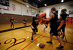 The Douglas High varsity football team practices inside the school gym, in Minden, Nev., on Tuesday, Aug. 27, 2013, due to unhealthy air caused by smoke from the Rim fire in Northern California. Air quality reached 343 in Minden earlier Tuesday.<br /> Photo by Cathleen Allison