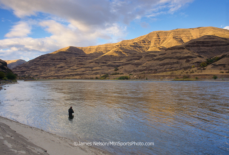 08013-W. An angler casts a fly for steelhead on the Snake River near Lewiston, Idaho.