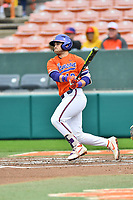 Clemson Tigers catcher Kyle Wilkie (10) swings at a pitch during a game against the North Carolina Tar Heels at Doug Kingsmore Stadium on March 9, 2019 in Clemson, South Carolina. The Tigers defeated the Tar Heels 3-2 in game one of a double header. (Tony Farlow/Four Seam Images)