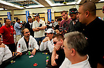 PS Team Pro Daniel Negreanu asks for a ruling during a hand from  a tournament oficial, at right.