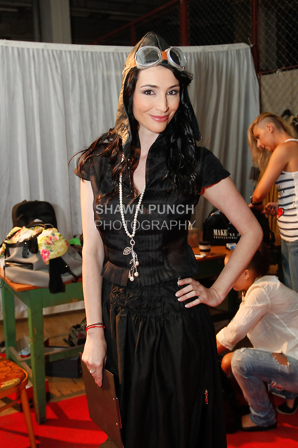 Model/Moderator Lucia Hablovicova poses backstage during hair and makeup prep for the Factory Fashion Show 2012, organized by Ina Budovksa in Trencin Slovakia, May 3, 2012.