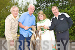 Declan Mangan left and Queen of Puck Cassie O'Grady welcomes the King of Puck to Killorglin on  Monday with goat catchers Seamus Blaney Antrim left and Frank Joy Killorglin