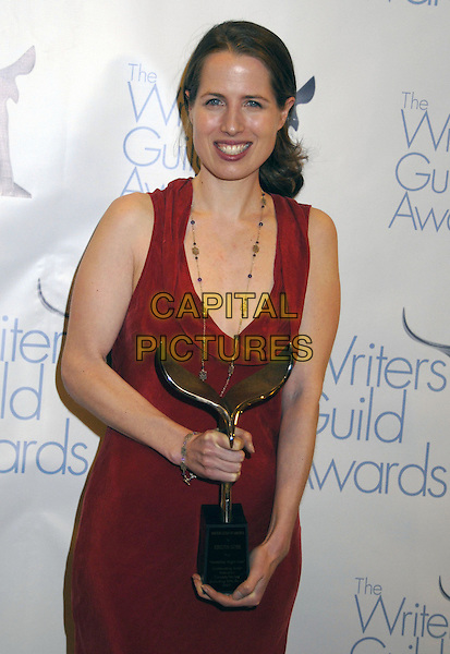 KRISTIN GORE.The Writers Guild of America West Awards held at the Hyatt Regency Century Plaza Hotel, Century City, California, USA. .February 11th, 2007.half length red dress award trophy .CAP/ADM/GB.©Gary Boas/AdMedia/Capital Pictures