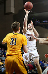 SIOUX FALLS, SD - MARCH 8:  Joel Wincowski #1 from Indiana Tech shoots over Michael Scott #31 from West Virginia University Tech at the 2018 NAIA DII Men's Basketball Championship at the Sanford Pentagon in Sioux Falls. (Photo by Dave Eggen/Inertia)