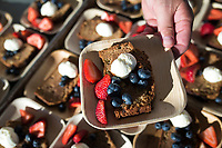 NWA Democrat-Gazette/CHARLIE KAIJO Chef Miles James of MJ Pizzeria in Springdale holds an apple cake topped with blueberries, strawberries and cream, Saturday, June 9, 2018 on Emma Ave. in Springdale. <br />
