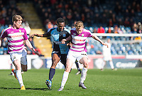 Anthony Stewart of Wycombe Wanderers holds off Harry Taylor of Barnet during the Sky Bet League 2 match between Wycombe Wanderers and Barnet at Adams Park, High Wycombe, England on 16 April 2016. Photo by Andy Rowland.