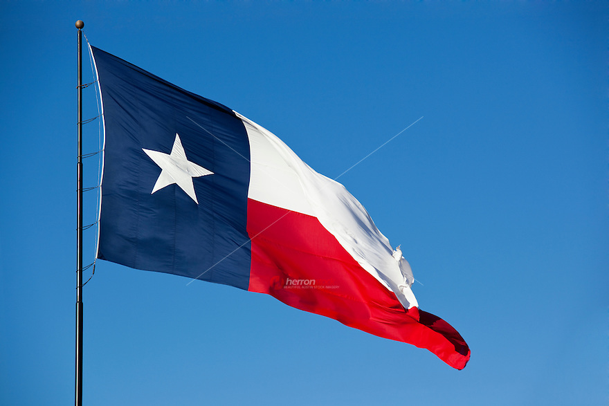 When Texas became the 28th state of the Union on December 29, 1845, its national flag became the state flag. While the Lone Star remained the de facto state flag, from 1879 until 1933 there was no official state flag. All statutes not explicitly renewed were repealed under the Revised Civil Statutes of 1879, and since the statutes pertaining to the flag were not among those renewed, Texas was formally flagless until the passage of the 1933 Texas Flag Code. The official Pantone shades for the Texas flag are 193 (red) and 281 (dark blue). The flag, flown at homes and businesses statewide, is highly popular among Texans and is treated with a great degree of reverence and esteem within Texas.