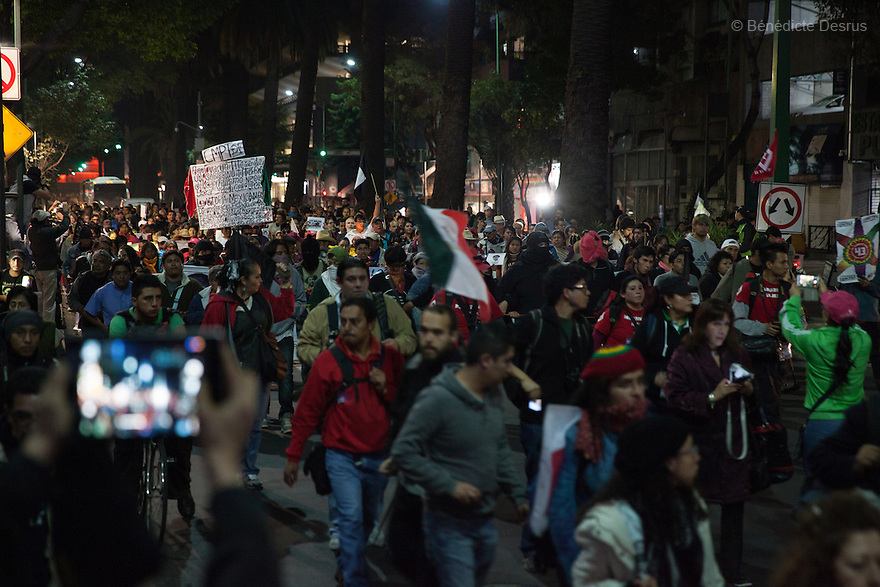 Demonstrators, along with the Parents and relatives of the 43 missing students of the Ayotzinapa Teacher Training College Raul Isidro Burgos, during a New Year's Eve march towards Los Pinos presidential residence in Mexico City, Mexico on December 31, 2014. The relatives of the 43 missing students do not believe the official line that the young men are all dead. The 43 students went missing on Sept. 26 after confrontations in which police gunfire killed six people and wounded at least 25 in Iguala, in Guerrero state. Alexander Mora Venancio, one of the 43 Ayotzinapa's missing students, has been identified and confirmed dead by authorities. Many are demanding justice and that the search for the 42 missing students continue until there is concrete evidence to the contrary. Mexico – officially - lists more than 20 thousand people as having gone missing since the start of the country's drug war in 2006, and the search for the missing students has turned up other, unrelated mass graves. (Photo by Bénédicte Desrus)