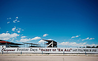 "The fence outside the stadium for Frontier Days in Cheyenne, Wyoming, Thursday, June 2, 2011.  It reads: Cheyenne Frontier Days ""Daddy of 'em All"" Last Full Week In July...Photo by Matt Nager"