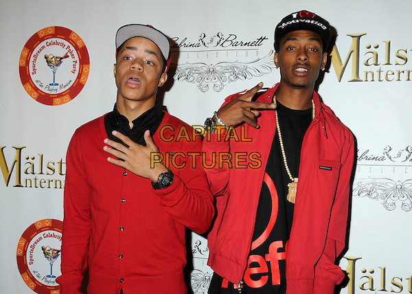"""NEW BOYZ.4th Annual Sports Dream Celebrity Poker and Pool Party Celebrating the 2010 ESPY Awards held at the Playboy Mansion, Beverly Hills, California, USA..July 12th, 2010.half length black red jacket cardigan Earl """"Ben J"""" Benjamin Dominic """"Legacy"""" Thomas jerkin crew and hip-hop/rap hand baseball cap hat.CAP/ADM/BP.©Byron Purvis/AdMedia/Capital Pictures."""