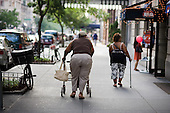 Two overweight women walk in the street in Manhattan, New York.