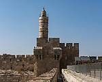The city wall of Jerusalem near the Jaffa Gate with the minaret of the Tower of David or the Citadel in the center.  The Old City of Jerusalem and its Walls is a UNESCO World Heritage Site.