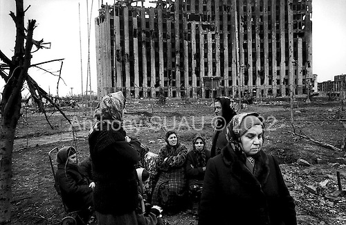 Grozny, Chechyna.1995.A group of women wait for a food distribution in front of the remains of the Presientual Palace. It never comes.