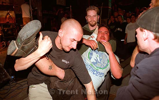 Guy being thrown out by security for the second time at NOFX at Brick's.<br />