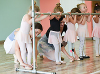 "NWA Democrat-Gazette/CHARLIE KAIJO Instructors Amber Casey (left) and Cailey Funkhouser (center) adjust the feet of dancers during a ballet summer mini-camp, Monday, July 8, 2019 at Radiance Ballet studio in Centerton. <br /> <br /> The studio is holding a three day summer mini-camp this week for three and four year olds. The class introduces youth to the foundations of ballet, and for many students, it's their first time. The class teaches them how their body's move and ways to use their imagination.<br /> <br /> ""[Ballet is] great for sensory input, coordination, balance and focus,"" said Tara Klamm, the studio's director. ""A lot of them it's the first time they've been in a structured class environment."""