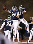 Nevada's Jerico Richarson (84) watches Cody Fajardo (17) and Jarred Gipson (47) celebrate after Fajardo scores against Fresno State in the first half of an NCAA college football game in Reno, Nev., on Saturday, Nov. 22, 2014. Fresno State won 40-20. (AP Photo/Cathleen Allison)