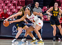COLLEGE PARK, MD - FEBRUARY 13: Stephanie Jones #24 of Maryland checks into McKenna Warnock #14 of Iowa during a game between Iowa and Maryland at Xfinity Center on February 13, 2020 in College Park, Maryland.