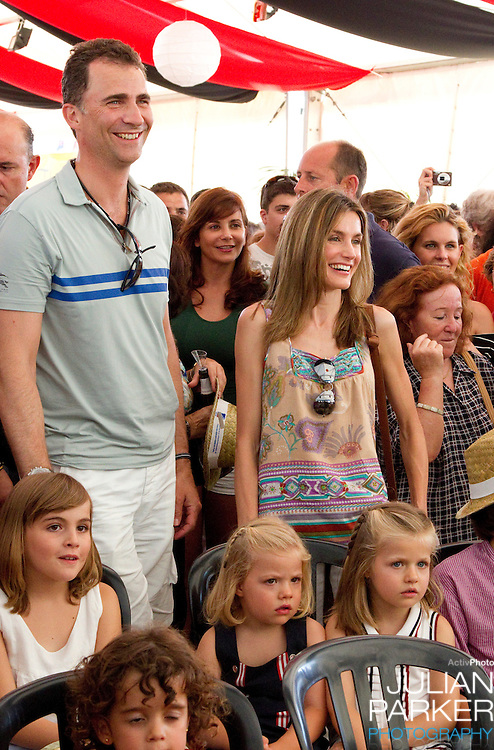 Crown Prince Felipe  and Crown Princess Letizia of Spain with their daughters, Leonor, and Sofia attend a concert, at The Royal Yacht Club, in Palma, Mallorca on the third day of the Copa Del Rey sailing regatta