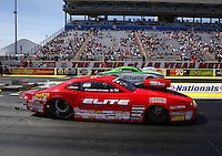 Mar 28, 2014; Las Vegas, NV, USA; NHRA pro stock driver Erica Enders-Stevens (near lane) races alongside Dave Connolly during qualifying for the Summitracing.com Nationals at The Strip at Las Vegas Motor Speedway. Mandatory Credit: Mark J. Rebilas-