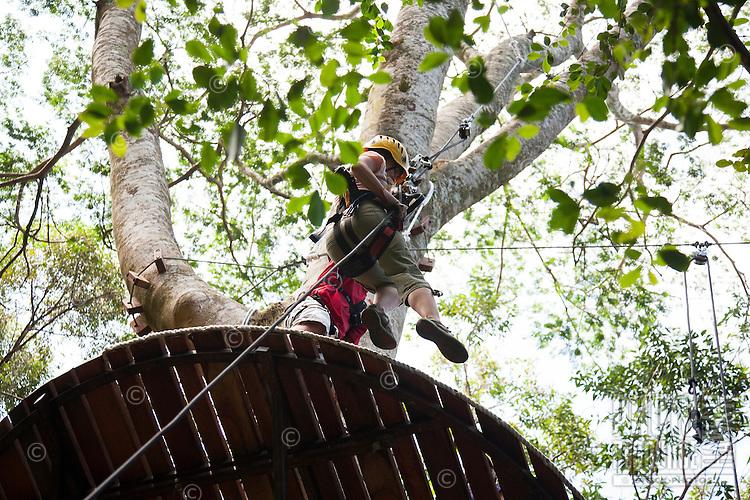 View below of woman on platform preparing to go Ziplining on the Big island with Kohala zipline