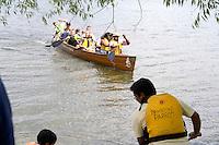Group paddling large Wilderness Inquiry canoe on Lake Calhoun. Aquatennial Beach Bash Minneapolis Minnesota USA