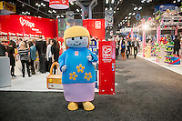 A character from Hape, a German toy company, attracts visitors to their booth at the 111th American International Toy Fair in the Jacob Javits Convention center in New York on Monday, February 17, 2014.  The four day trade show with over 1000 exhibitors connects buyers and sellers and is expected to draw tens of thousands of attendees.  The toy industry generates  $22 billion in the United States and Toy Fair is the largest toy trade show in the Western Hemisphere. (© Richard B. Levine)