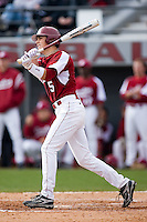 Whit Merrifield (5) of the South Carolina Gamecocks follows through on a 2-run home run versus the East Carolina Pirates at Sarge Frye Field in Columbia, SC, Sunday, February 24, 2008.