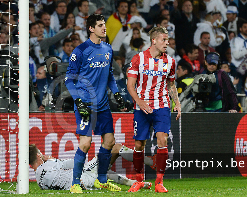 20140524 - LISBON , PORTUGAL : Atletico's goalkeeper Thibaut Courtois (left) pictured with his teammate Toby Alderweireld during soccer match between Real Madrid CF and Club Atletico de Madrid in the UEFA Champions League Final on Saturday 24 May 2014 in Estadio Da Luz in Lisbon .  PHOTO DAVID CATRY