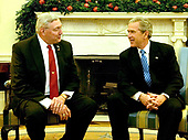Washington, D.C. - November 30, 2005 -- United States President George W. Bush, right, meets Jim Mueller, National Commander-in-Chief of the Veterans of Foreign Wars (VFW), left, in the Oval Office in the White House on November 30, 2005.<br /> Credit: Ron Sachs - Pool via CNP
