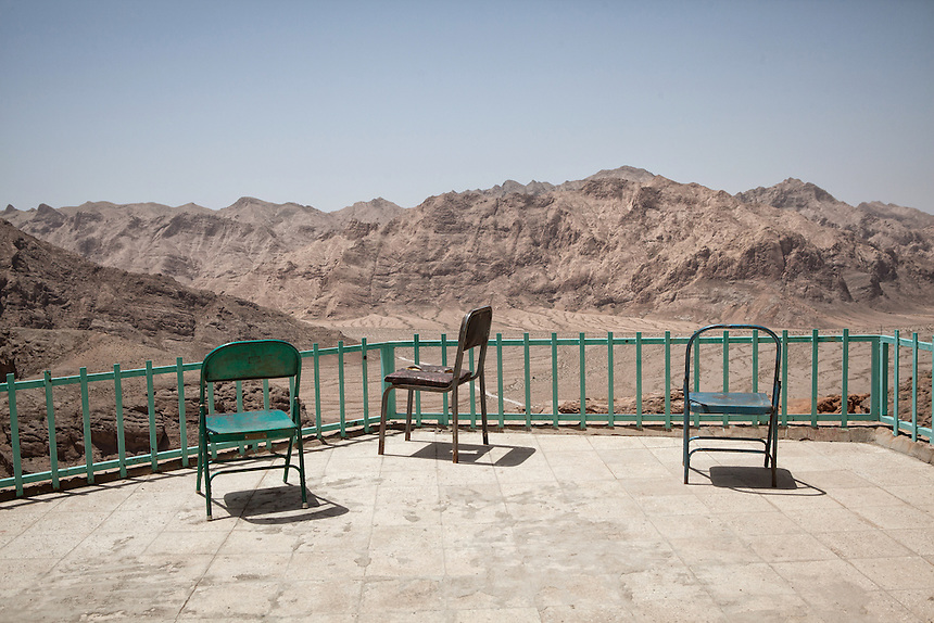 Empty chairs overlooking the mountain range around chak Chak. Located 70 km from Yazd. This place is Iran's most important Zoroastrian pilgrimage centre.