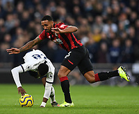 30th November 2019; Tottenham Hotspur Stadium, London, England; English Premier League Football, Tottenham Hotspur versus AFC Bournemouth; Callum Wilson of Bournemouth fouls Tanguy Ndombele of Tottenham Hotspur - Strictly Editorial Use Only. No use with unauthorized audio, video, data, fixture lists, club/league logos or 'live' services. Online in-match use limited to 120 images, no video emulation. No use in betting, games or single club/league/player publications