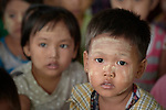 Children in a church-run preschool in Tuingo, an ethnic Chin village in Myanmar. They have thanaka, a cosmetic paste, on their faces.