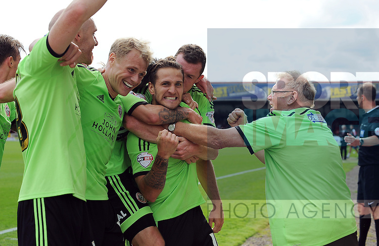 Billy Sharp of Sheffield United celebrates scoring his goal to make it 2-0 with team mates and a disabled sheffield united supporter (right)<br /> - English League One - Swindon Town vs Sheffield Utd - County Ground Stadium - Swindon - England - 29th August 2015
