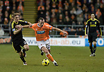 Blackpool 2 Liverpool 1, 12/01/2011. Bloomfield Road, Premier League. Blackpool FC's Scottish midfielder Charlie Adam in action against Liverpool FC in a Premier League match at Bloomfield Road stadium. The home side won by two goals to one in front of a crowd of 16,089. It was the first time the clubs had met in a league match since Blackpool were last in the top division of English football in 1970-71. Photo by Colin McPherson.