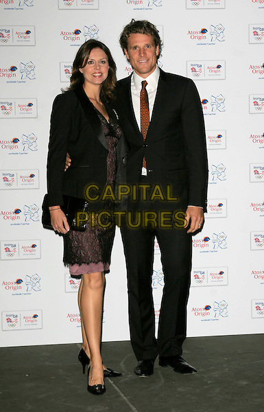 BEVERLEY TURNER & JAMES CRACKNELL .attends the Olympic Gold Ball at the Natural History Museum, London, England, October 8th 2008..full length black suit tie jacket purple lace dress shoes .CAP/AH.©Adam Houghton/Capital Pictures