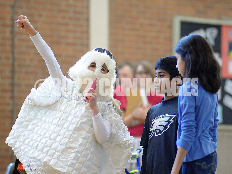 SODYSSEY28P<br /> From left, Brayden Naskiewicz points to the ceiling while speaking with Thomas Cherian and Heeya Jagirdar of Afton Elementary School as they demonstrate their solution to No-Cycle Recycle during the Southeast Pennsylvania Odyssey of the Mind tournament Saturday February 27, 2016 at Pennsbury High School West in Fairless Hills, Pennsylvania. (William Thomas Cain/For The Inquirer)