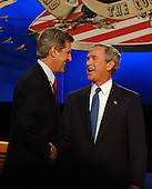 Coral Gables, FL - September 30, 2004 -- United States President George W. Bush, right, shakes hands with his Democratic challenger United States Senator John F. Kerry (Democrat of Massachusetts) at the start of the first of their three scheduled meetings at the University of Miami in Coral Gables, Florida on September 30, 2004. .Credit: Ron Sachs / CNP