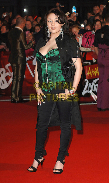 MUTYA BUENA.attending the 2007 Brit Awards, Earls Court, .London, England,14th February 2007..Brits full length green corset top tattoo cleavage breast boob black shirt dress skinny jeans.CAP/ BEL.©Tom Belcher/Capital Pictures.
