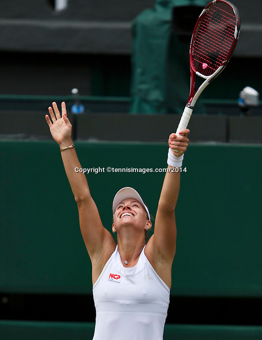 England, London, 28.06.2014. Tennis, Wimbledon, AELTC, Angelique Kerber (GER) defeats Sharapova and celebrates<br /> Photo: Tennisimages/Henk Koster