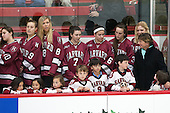 The women's team lined up on the home bench during the pre-game ceremony. - The Harvard University Crimson tied the visiting Dartmouth College Big Green 3-3 in both team's first game of the season on Saturday, November 1, 2014, at Bright-Landry Hockey Center in Cambridge, Massachusets.