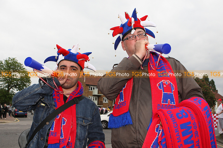 Merchandise sellers are seen blowing their horns - League Two Play-Off winners Dagenham & Redbridge FC attend a reception at Dagenham Civic Centre and then journey back to Victoria Road by open top bus - 31/05/10 - MANDATORY CREDIT: Gavin Ellis/TGSPHOTO - Self billing applies where appropriate - Tel: 0845 094 6026