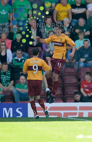 Well's John Sutton(11) jumps into the air to celebrate the opening goal with team matre Jamie Murphy(9) during The Clydesdale Bank Premier League match between Motherwell and Hibernian at Fir Park 15/08/10..Picture by Ricky Rae/universal News & Sport (Scotland).