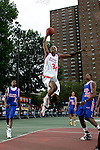 Donte Greene (34) goes up for a dunk during the Elite 24 Hoops Classic game on September 1, 2006 held at Rucker Park in New York, New York.  The game brought together the top 24 high school basketball players in the country regardless of class or sneaker affiliation.