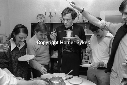Cheese Fondu party. Very popular amongst the aspiring middle class of the time.  This group all went on to become  successful lawyers, bankers and bursars. Suburban Southfields, Wimbledon SW19. England. 1980.